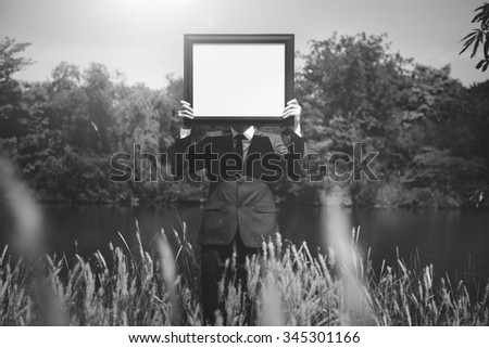 Businessman Holding Picture Frame Copy Space Concept - stock photo