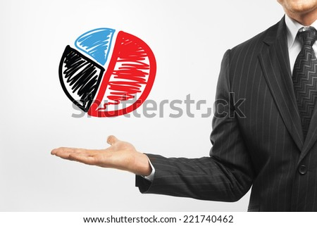 businessman holding pie chart on a white background - stock photo