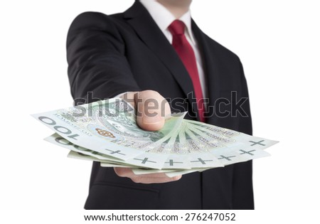 Businessman holding polish money. Clipping path included. - stock photo