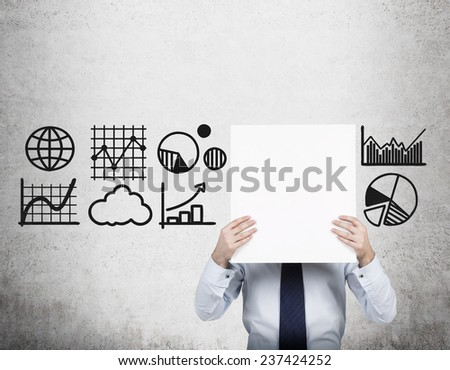 businessman holding poster with charts and graphs - stock photo