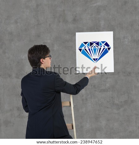 businessman holding poster with drawing blue brilliant - stock photo