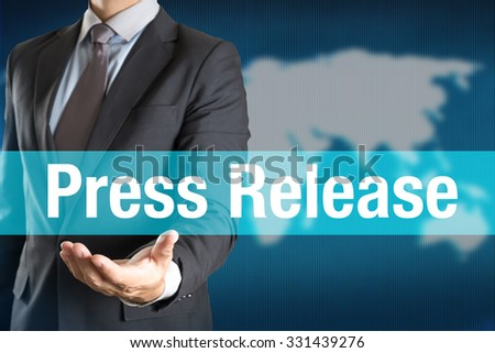 Businessman holding PRESS RELEASE word with world background - stock photo