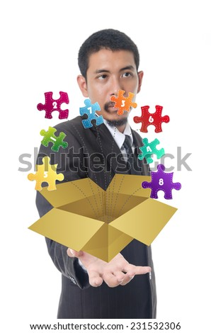 Businessman Holding Progress Jigsaw Puzzle Icons in Box for Eight Steps, For Business and Technology Concept, - stock photo