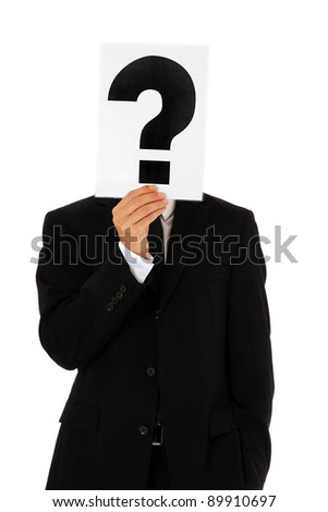 Businessman holding question mark in front of his head. All on white background. - stock photo