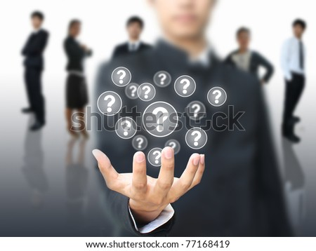 Businessman holding question sign - stock photo