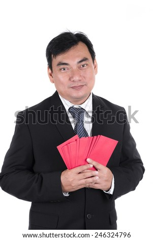 Businessman holding red Chinese new years envelopes - stock photo