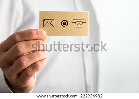 Businessman Holding Small Card with Contact Icons. Over White Background. - stock photo
