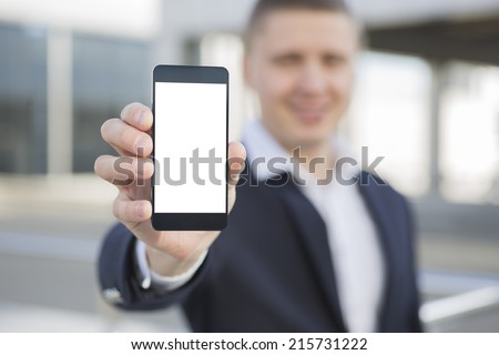 Businessman holding smartphone in hand - stock photo