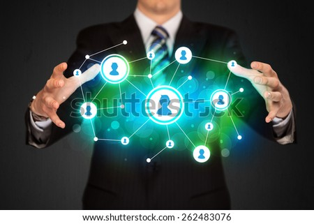 Businessman holding social media network icons structure