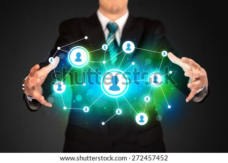 Businessman holding social media network icons structure - stock photo