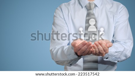 Businessman holding social media people icons in hands - stock photo