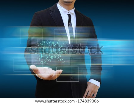 Businessman holding social network icons.