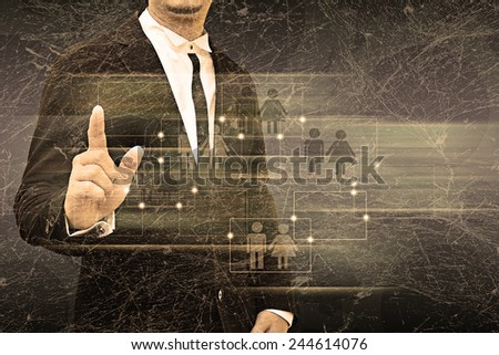 Businessman holding social network in the old texture - stock photo