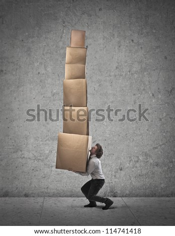 Businessman holding some boxes