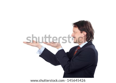 businessman holding something on his hands against white background - stock photo
