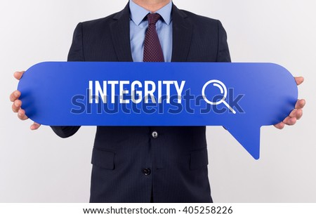 Businessman holding speech bubble with a word INTEGRITY - stock photo