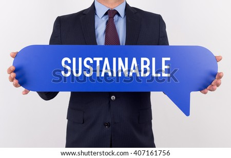 Businessman holding speech bubble with a word SUSTAINABLE - stock photo