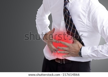 businessman holding stomach for show his stomachache with white  background - stock photo