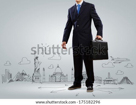 Businessman holding suitcase against sketch background. Business travel