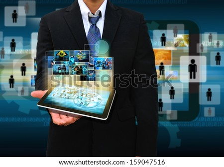 businessman holding tablet technology business concept - stock photo