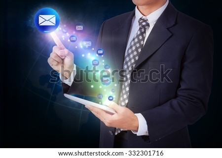 Businessman holding tablet with pressing mail sign icon button. internet and networking concept - stock photo