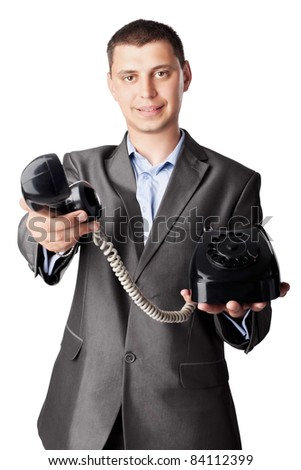 businessman holding telephone receiver isolated on white background - stock photo