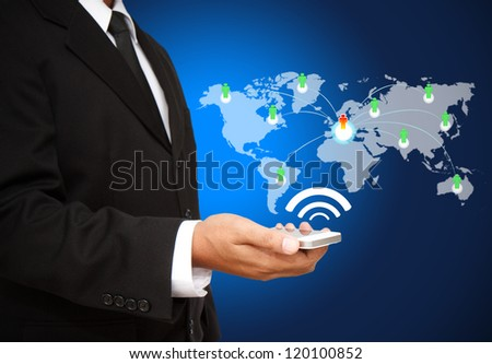 Businessman holding the Phone with social network structure - stock photo