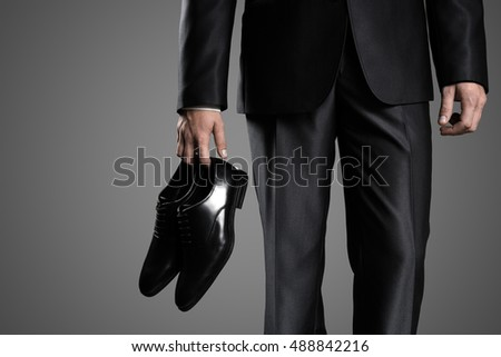 Businessman Holding The Shoes In Hand, Close Up.