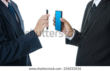 Businessman Holding touch screen mobile phone. - stock photo
