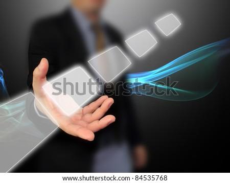 Businessman holding touchscreen - stock photo
