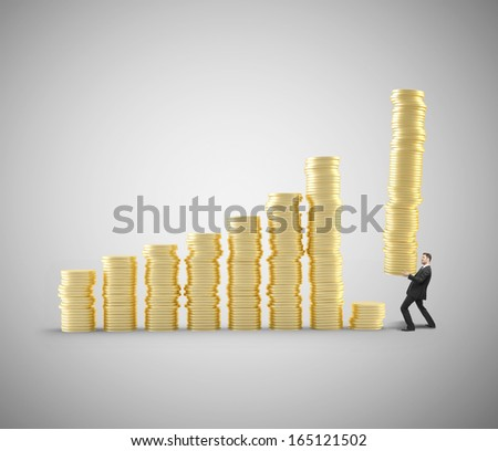businessman holding tower of coins with coins