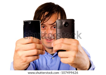 Businessman holding two mobile phones - stock photo