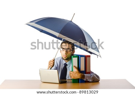 Businessman holding umbrella in the office - stock photo