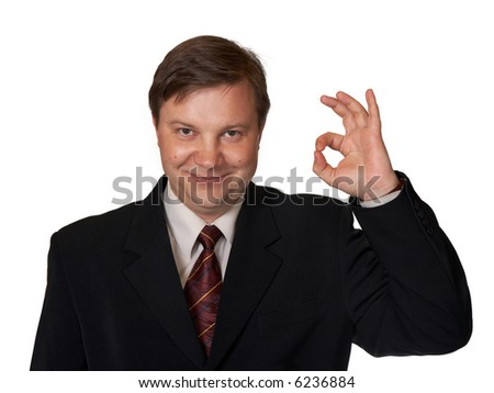 Businessman holding up an OK sign, isolated on white background - stock photo