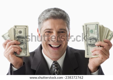Businessman Holding US One Hundred Dollar Bills - stock photo