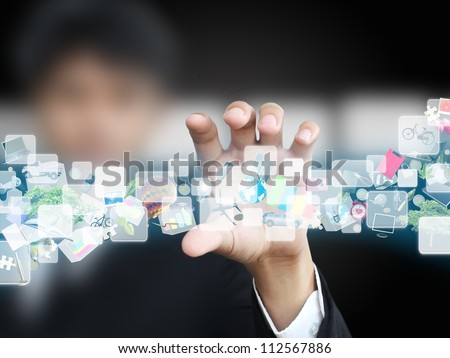 Businessman holding virtual object - stock photo