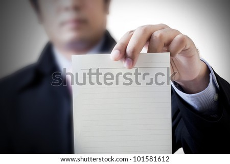 Businessman holding white billboard - stock photo