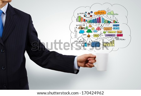 Businessman holding white blank cup in hand