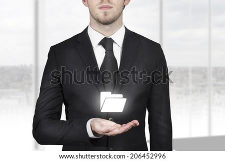 businessman holding white folder symbol - stock photo