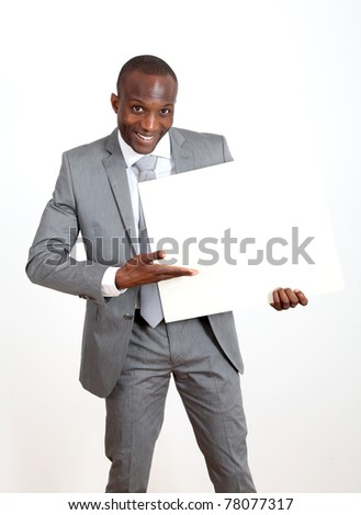 Businessman holding white message board