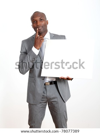 Businessman holding white message board - stock photo