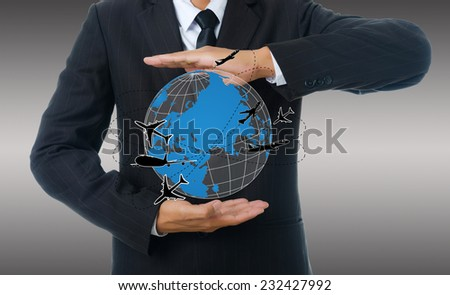 Businessman Holding World Map Globe for Business and Technology concept. with airplane and globe.