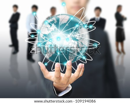 Businessman holding world network - stock photo
