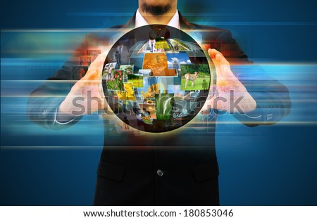 businessman holding world  social network - stock photo