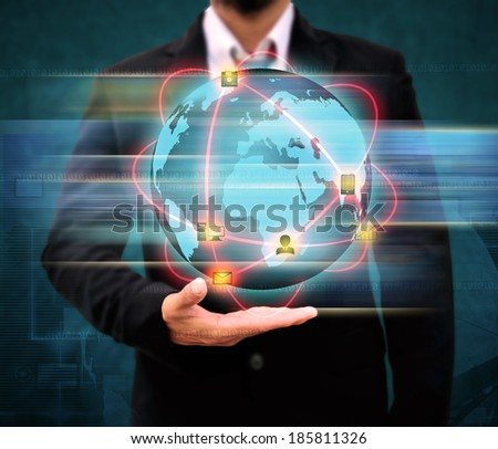 Businessman holding world Technology  - stock photo