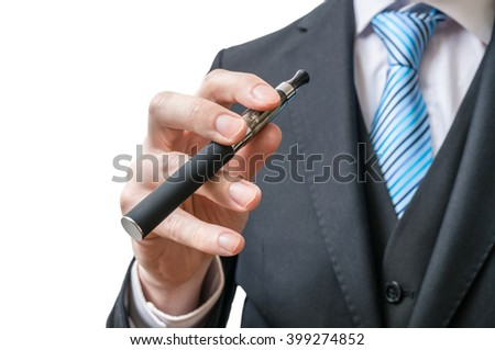 Businessman holds electronic cigarette in hand. Isolated on white background.