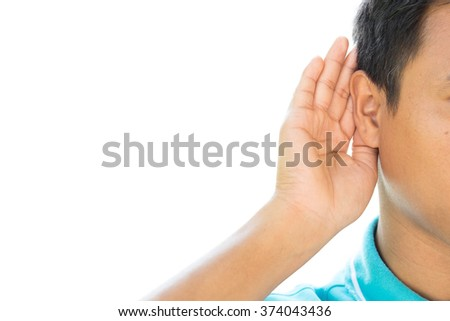 Businessman holds his hand near ear and listening something - stock photo