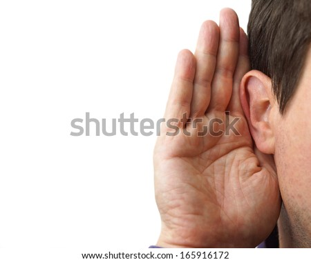 Businessman holds his hand near his ear and listening - stock photo