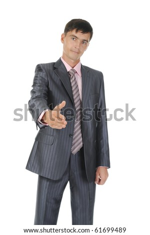 Businessman holds out his hand for a handshake. Isolated on white background
