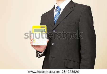 businessman holds the calculator